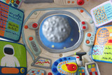 Window of spaceship with Dashboard looking at moon.Plasticine