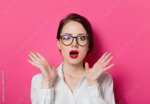 Portrait of young surprised businesswoman in eyeglasses - 188490326