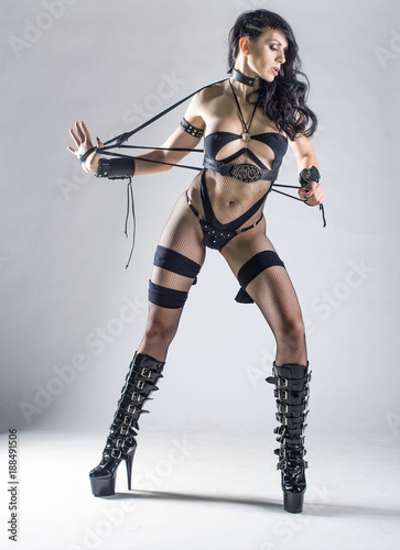 b6e3a9a43a85be fototapeta na ścianę Sexy fetish woman in lingerie holding whip, isolated  on white