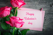 Card for St. Valentine's Day, Mother's Day. Day of Womans. Pink roses against a dark background.