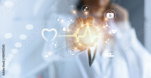Medicine doctor with  stethoscope in hand touching icon medical network connection with modern virtual screen interface, medical technology network concept © ipopba