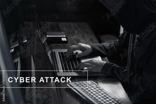 Foto Murales Internet crime. Hacker using laptop and hacking code password in dark room. Cyber attack concept