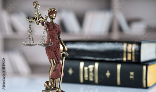 Law and Justice concept. Mallet of the judge, books, scales of justice. Gray stone background, reflections on the floor, place for typography. Courtroom theme. - 188501100