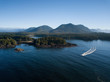 Aerial panoramic landscape view of the rocky Pacific Ocean Coast during a vibrant summer morning. Taken in Ucluelet, Vancouver Island, British Columbia, Canada.