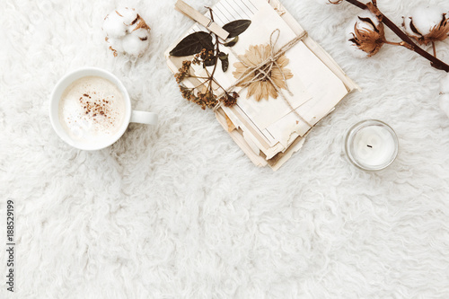 Foto Murales Flat lay composition with coffee, dry flowers, cotton and old letters. vintage toning background