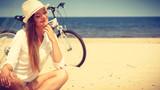 Girl with bike on beach. - 188536172
