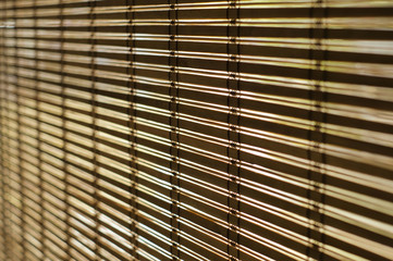 select focus Wood blinds or curtain and sunlight in behind
