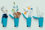 top view of trash bins and assorted garbage isolated on grey, recycle concept - 188538515