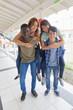 Two multi races teenager couples piggybacking on the school hallway