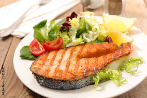 Fotobehang Steakhouse grilled salmon steak with salad