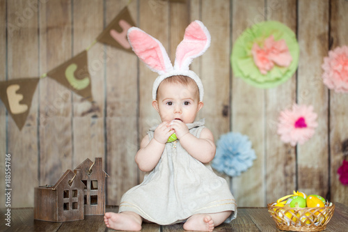 Cute baby in easter decorated studio