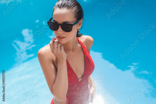high angle view of sensual young woman in swimsuit at swimming pool