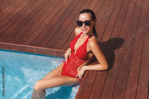 beautiful young woman in swimsuit at swimming pool