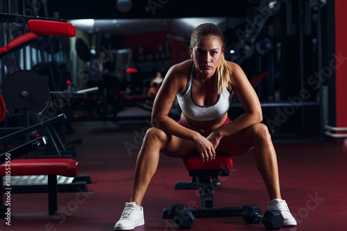 Fridge magnet Portrait of young woman in the gym.