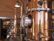 Leinwanddruck Bild - alembic still for making alcohol inside distillery, destilling spirits