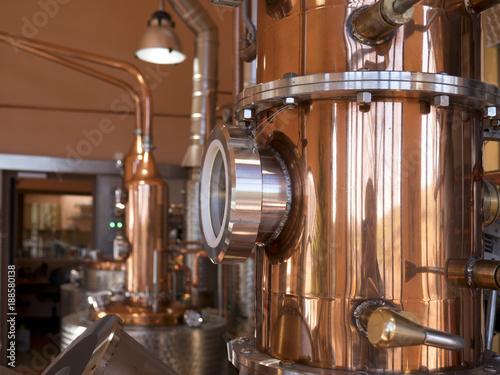 Leinwanddruck Bild alembic still for making alcohol inside distillery, destilling spirits