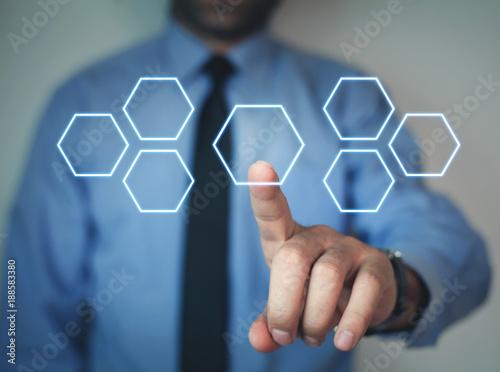 Foto Murales Businessman touching blank hexagonal button.