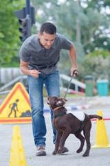 Man training energetic dog