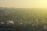 Evening panoramic cityscape downtown of Paris in backlit sunbeam. View from the Basilica of Sacre-Coeur. - 188585514