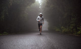 Portrait of a young athlete running on the road - 188593958