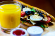 grilled sandwich with various cold meats, cheese, mushrooms, tomato and egg, tasty and healthy snack