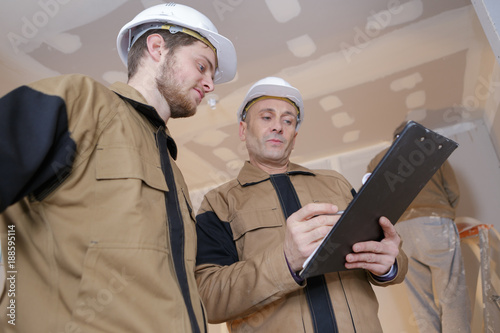 builder holding a file