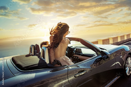 Foto op Canvas Artist KB Relaxed couple riding a convertible