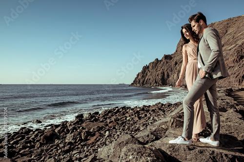 Foto op Canvas Artist KB Elegant, young couple watching ocean's waves