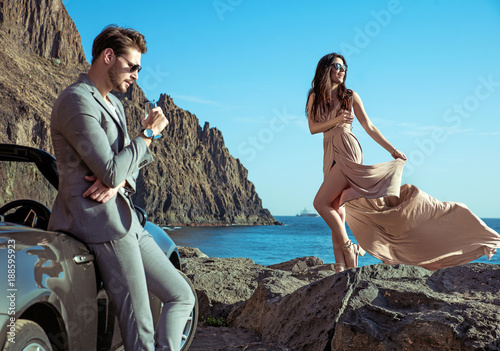 Foto op Canvas Artist KB Young couple relaxing by the sea