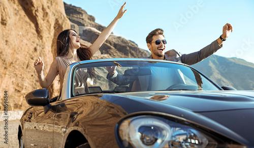 Papiers peints Artiste KB Smart couple riding a luxurious convertible