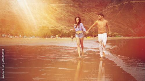 Foto op Canvas Artist KB Attractive couple walking along the seaside