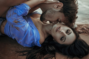 Handsome man kissing his sensual woman