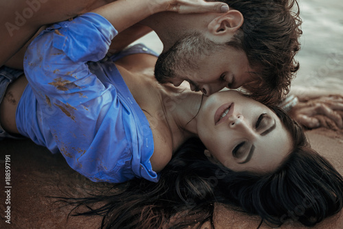 Fotobehang Konrad B. Handsome man kissing his sensual woman