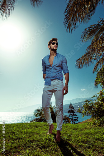 Fotobehang Konrad B. Handsome man relaxing on vacation in a tropical place