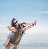 Conceptual portrait of a young, cheerful couple on vacation - 188599153