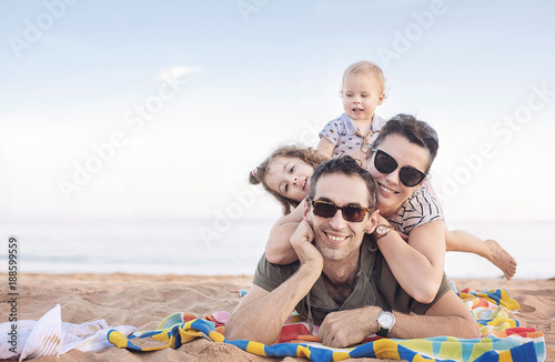 Foto op Canvas Artist KB Cheerful family posing on a beautiful beach