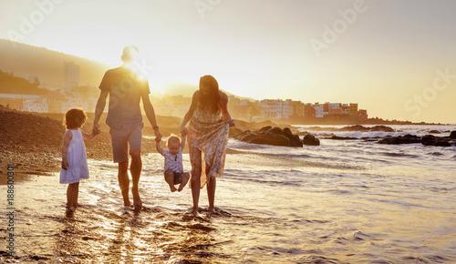 Papiers peints Artiste KB Cheerful family having fun on a beach, summer portrait