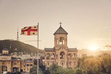 The bell tower of the Trinity Cathedral of Tbilisi and a beautiful sunset.