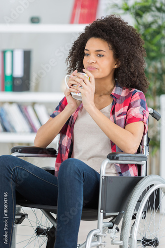 handicapped woman drinking beverage