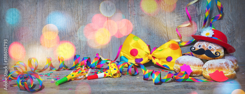 Carnival donuts with paper streamers and party bow tie - 188605793