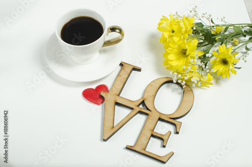 Spring flowers, yellow daisies. Postcard to the St. Valentine's Day. February. Black coffee in a white cup.