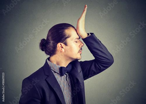 Foto op Aluminium Kasteel Man blaming himself in stupid behaviour