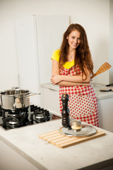 Beautiful young woman cook a meal in the kitchen
