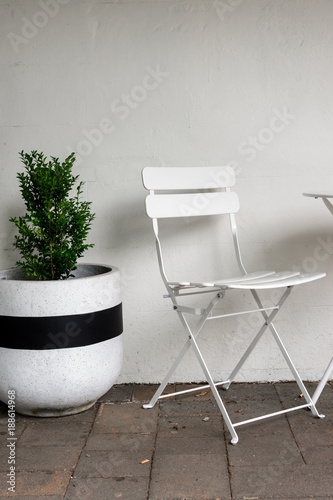 simple table and chairs against wall