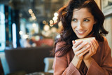 woman drinking coffee in a cafe
