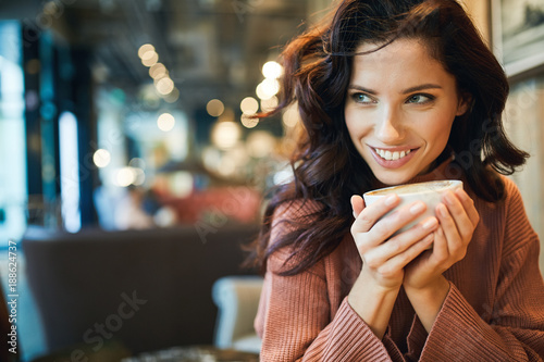 woman drinking coffee in a cafe - 188624737