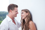 portrait of nice young couple on white wall background - 188633576