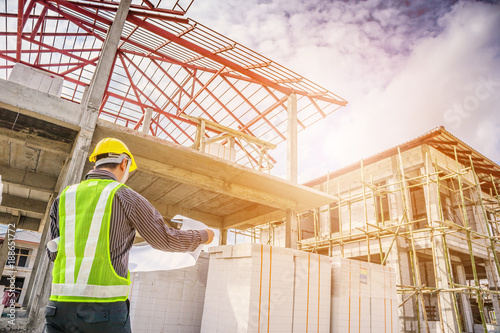 Asian business man construction engineer worker at house building site