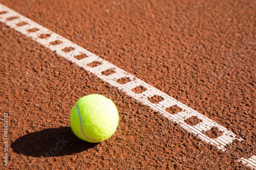 Fototapeta tennis ball with line on a sand court