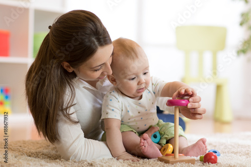 little child boy and his mommy play with toys at home © Oksana Kuzmina